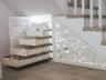Drewniana ozdobna zabudowa wnęki pod schodami -  szuflady na wino